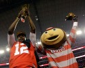 Ohio State's Cardale Jones and their mascot celebrate after the NCAA college football playoff championship game against Oregon Monday, Jan. 12, 2015, in Arlington, Texas. Ohio State won 42-20.
