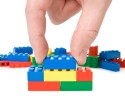 close-up of hand building a color plastic bricks